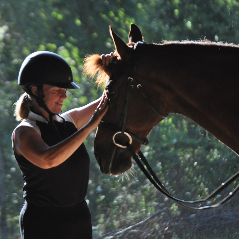 Woman with her Morgan horse