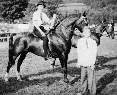 "Lyman Orcutt & Ulysses ""Lyman Orcutt showed Ulysses to Grand Champion Stallion honors and three blue ribbons at the 1939 Morgan Show. Carlos Allen (standing), the great-great-great-great grandson of Justin Morgan, was invited to present awards."""